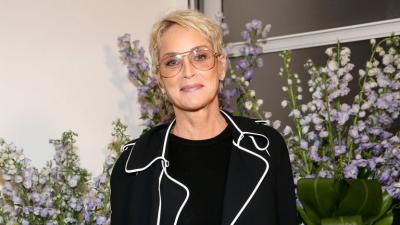 Sharon Stone, black vest, glasses