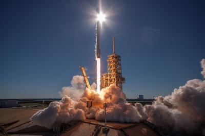 Falcon 9 rocket launch, sun, booster fire