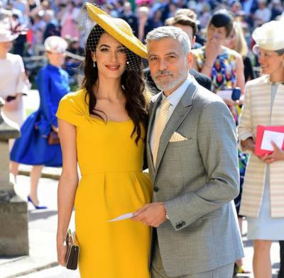 Amal Clooney in bold yellow dress