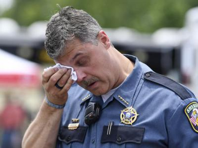 Dickson County Sheriff Jeff Bledsoe wipes a tear as he talks about Sgt. Daniel Baker