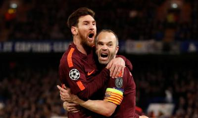 Lionel Messi celebrates the equaliser with Andres Iniesta.