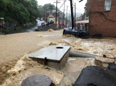Flooding overtakes Main Street in Ellicott City, Maryland, after heavy rains and storms on Sunday, May 27, 2018.