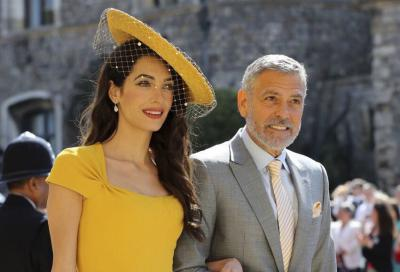George and Amal Clooney cringe