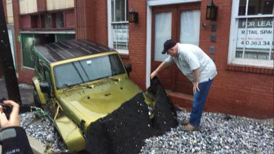 Governor Larry Hogan inspects a sunken vehicle